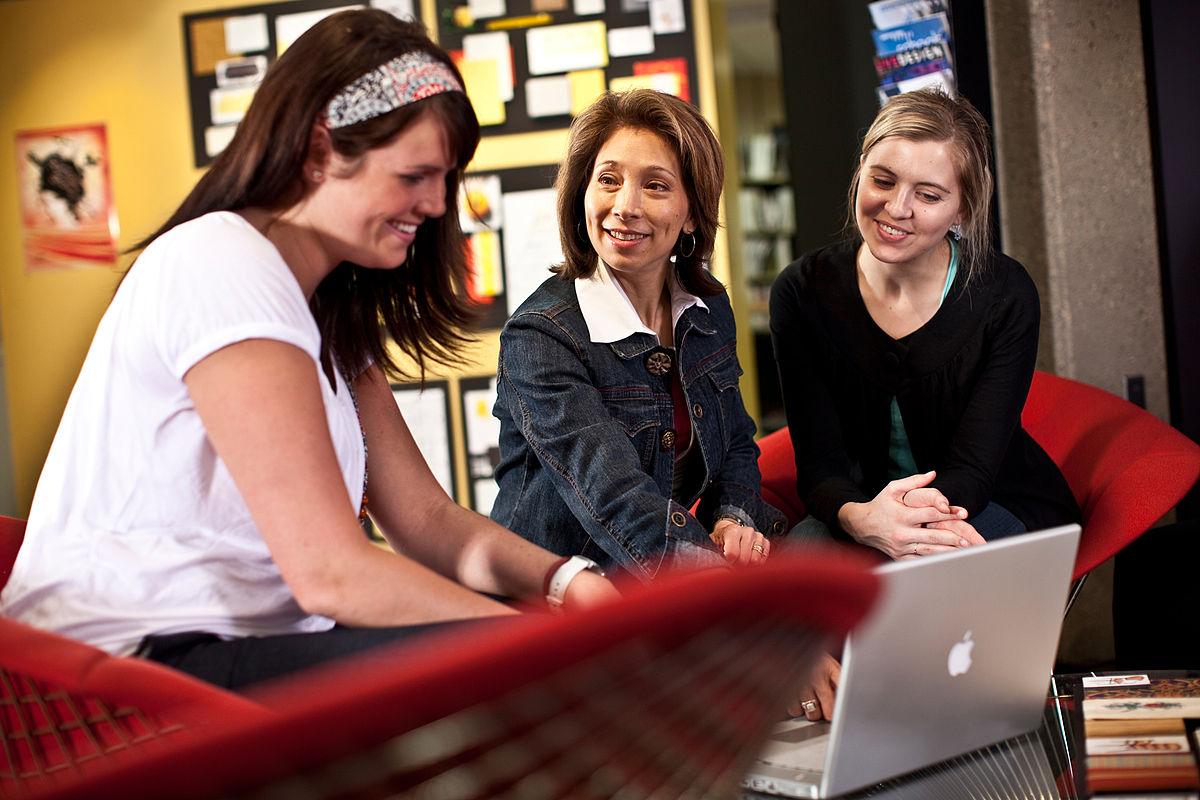 2 Ladies Discussing the Interior Designing Project with Interior Designer